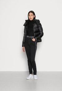Calvin Klein Jeans - SHINY  - Down jacket - black - 1