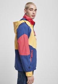 Starter - MULTICOLORED LOGO - Kevyt takki - red/blue/yellow - 4