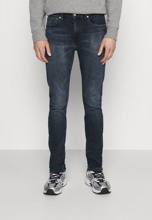 TAPER - Slim fit jeans - denim dark
