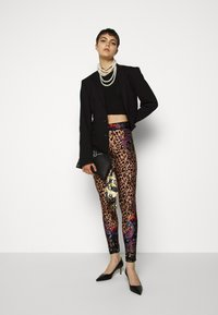 Versace Jeans Couture - Leggings - Trousers - nero - 1
