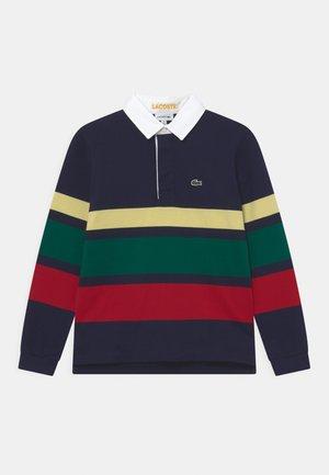 Polo - marine/jaune