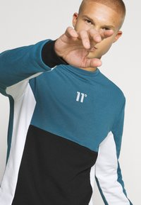 11 DEGREES - CUT AND SEW - Mikina - black /indian teal/white - 4
