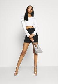 Missguided - DISTRESSED SKIRT - Denim skirt - black - 1