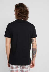 Calvin Klein Jeans - CENTERED MONOGRAM SLIM TEE - Print T-shirt -  black - 2