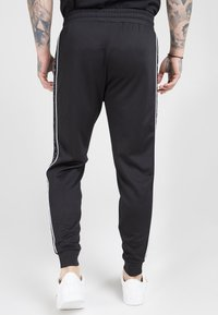 SIKSILK - FITTED PANEL TAPE TRACK PANTS - Tracksuit bottoms - black - 2