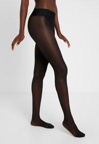 DIM - SEMI OPAQUE NUDE SENSATION BODY TOUCH - Tights - black - 0