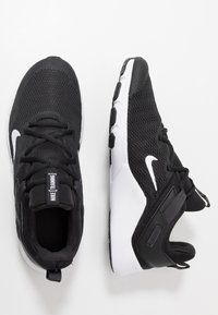 Nike Performance - LEGEND ESSENTIAL - Sports shoes - black/white/dark smoke grey - 1