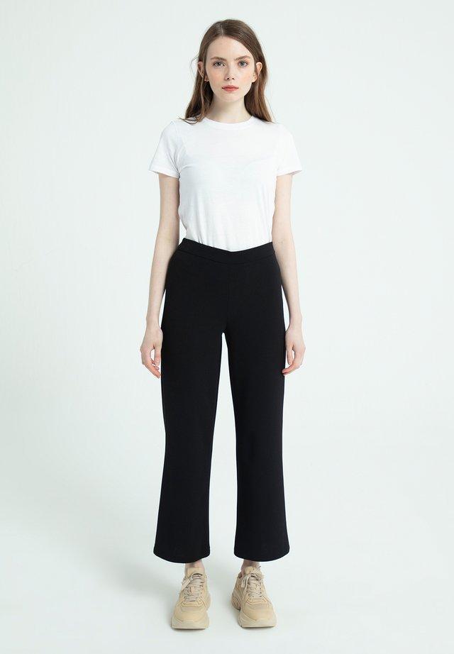 PLENTY TROTTER  - Trousers - siyah