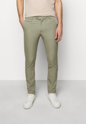 COMO LIGHT SUIT PANTS - Kostymbyxor - lichen green