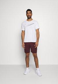 Nike Performance - TRAIN - Pantalón corto de deporte - mystic dates/blue void/black - 1