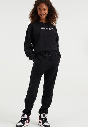 MET OPDRUK - Pantalones deportivos - black