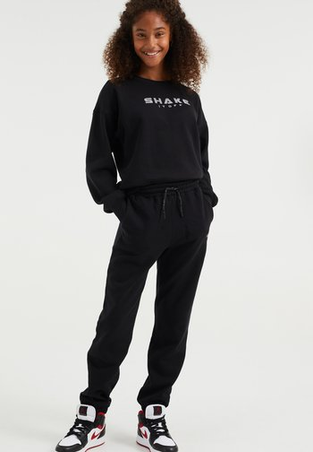 MET OPDRUK - Spodnie treningowe - black