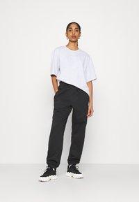 adidas Originals - PANT - Tracksuit bottoms - black - 1