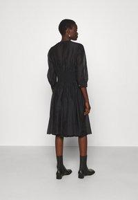 KARL LAGERFELD - DRESS SMOCKING WAIST - Day dress - black - 2