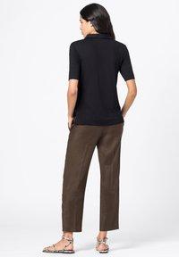 HALLHUBER - Button-down blouse - schwarz - 1