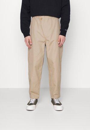 SHAPES TRIANGLE FRONT UNISEX - Trousers - khaki