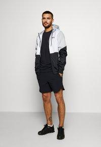 Under Armour - FIELD HOUSE JACKET - Waterproof jacket - white/black - 1