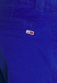 Tommy Jeans - SCANTON PANT - Trousers - blue - 5