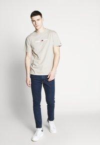 Wrangler - BRYSON - Jeans Skinny Fit - dark-blue denim - 1