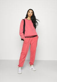 BDG Urban Outfitters - PANT - Tracksuit bottoms - washed red - 1