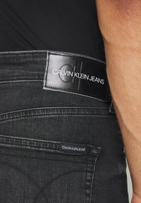 Calvin Klein Jeans - SLIM TAPER - Slim fit jeans - washed black - 3