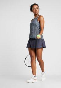 Nike Performance - W NKCT - Sports shirt - black/white - 1