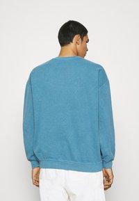 BDG Urban Outfitters - UNISEX BLUE EAGLES - Sweatshirt - blue - 2
