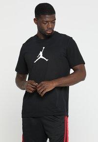 Jordan - ICON TEE - Print T-shirt - black/white - 0