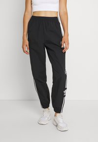 adidas Originals - TRACK PANTS - Spodnie treningowe - black - 0