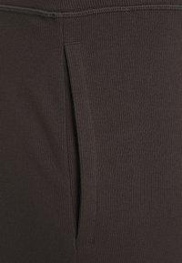 Puma - EXHALE PLUS SIZE - Pantalon de survêtement - after dark - 2