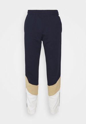 PANT TAPERED - Teplákové kalhoty - navy blue