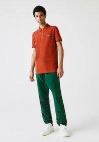 Lacoste - Polo shirt - braun - 0