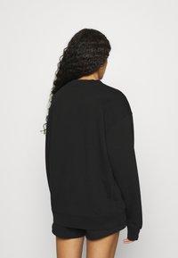 Calvin Klein Jeans - EMBROIDERY ECO WASH CREWNECK - Sweatshirt - black - 2