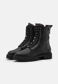 Mexx - FLARE - Stivali da neve  - black - 2