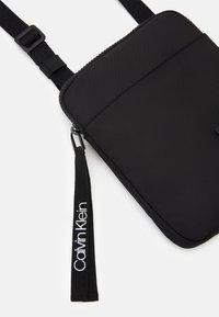Calvin Klein - FLAT PACK  - Across body bag - black - 3