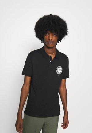 EXCLUSIVE ZEBRA PRINT - Polo shirt - black