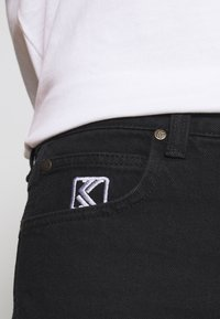 Karl Kani - RINSE PANTS - Relaxed fit jeans - black - 6