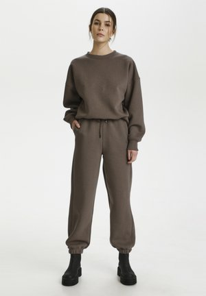 RUBI - Tracksuit bottoms - earth