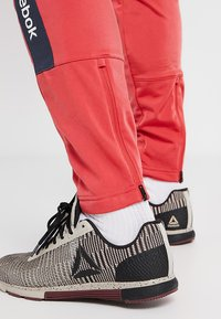 Reebok - TRAINING ESSENTIALS TRACK PANTS - Tracksuit bottoms - red - 5