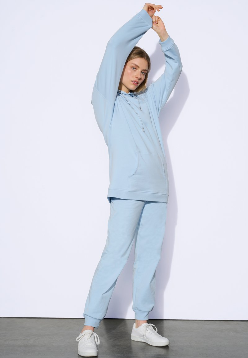 ORSAY - Tracksuit bottoms - light blue