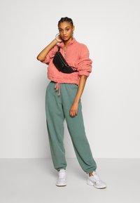 Topshop - BORG FUNNEL POCKET - Fleece jumper - pink - 1