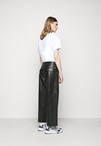 Holzweiler - TEFF TROUSER  - Leather trousers - black - 2