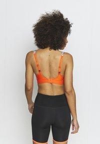 triaction by Triumph - HYBRID LITE - High support sports bra - orange - 2