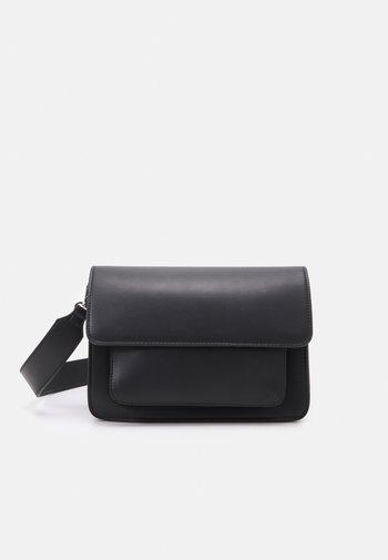 BASEL RESPONSIBLE - Across body bag - jet black