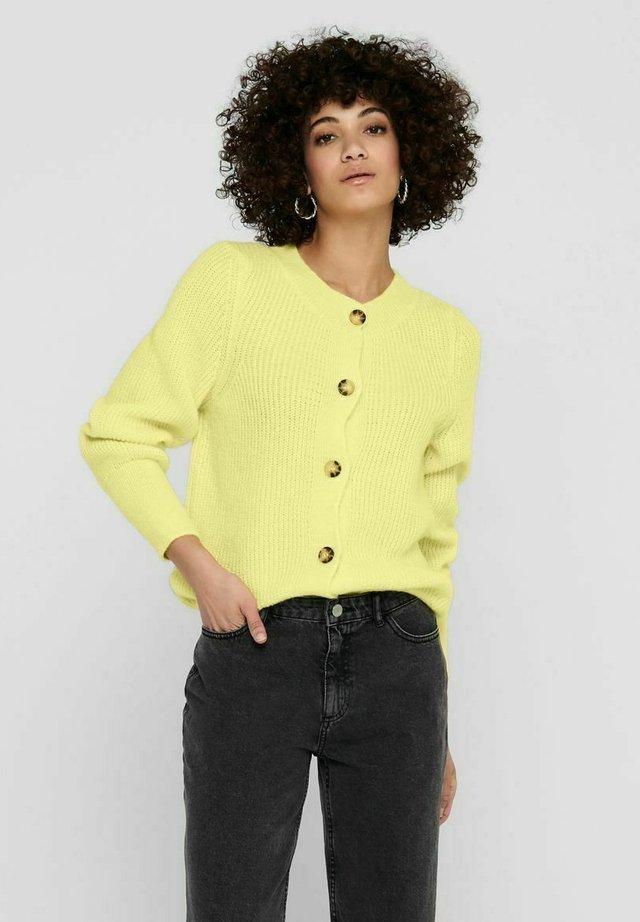 Chaqueta de punto - pastel yellow