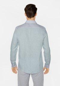 WE Fashion - SLIM-FIT - Koszula - light blue - 2