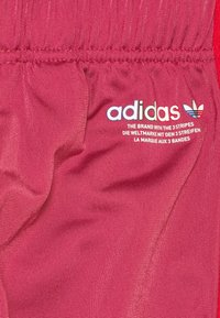 adidas Originals - TRACKPANT UNISEX - Tracksuit bottoms - wild pink - 2