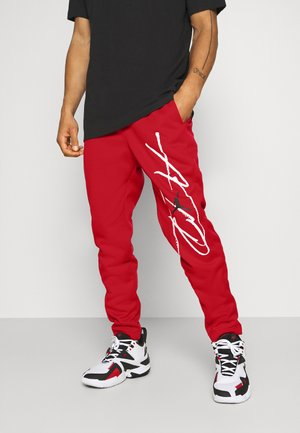 AIR THERMA PANT - Verryttelyhousut - gym red/black