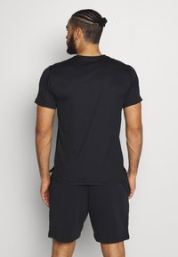 Nike Performance - Basic T-shirt - black/white - 2
