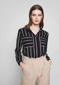 ONLY - ONLFREYA  - Button-down blouse - black/cloud dancer - 4